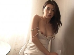 Stunning Japanese masturbator lets a dude finger her hairy twat