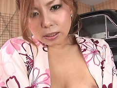 Traditionally dressed Japanese redhead toys her twat in the garage